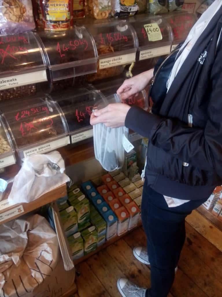Using reusable cloth bags at the bulk bin store