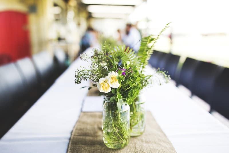 Jam Jar Vases Flowers from the Garden and Hessian Table Runner