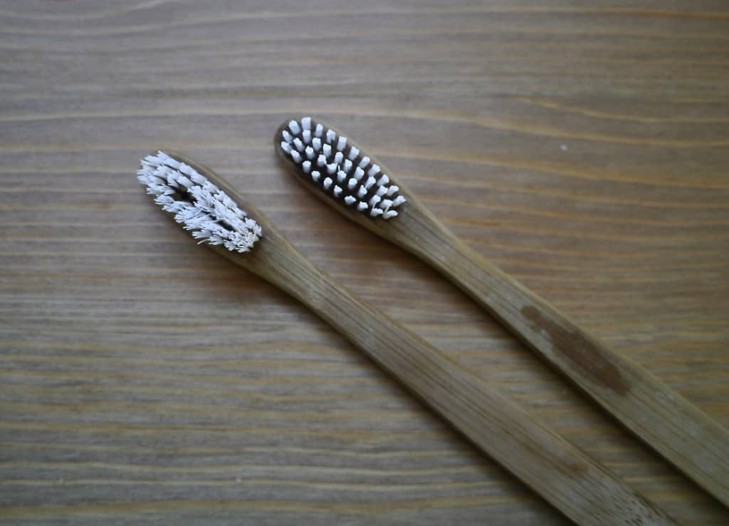 The old toothbrush on the left, and a new one